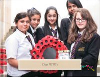 Cover Page of Book: Our WW1 <br/><br/>Image of the five students from Marsden Heights Community College who created this book, holding a poppy wreath.
